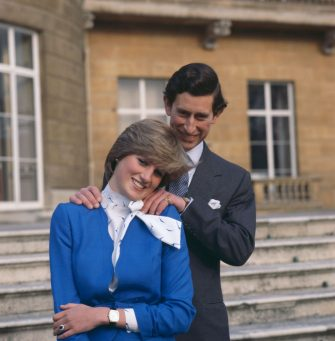24th February 1981:  Charles, Prince of Wales laughing with his fiancee Lady Diana Spencer (1961 - 1997) outside Buckingham Palace, London after announcing their engagement.  (Photo by Hulton Archive/Getty Images)