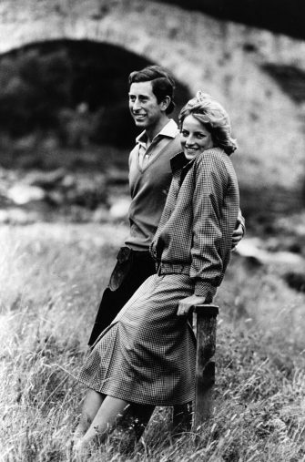 Charles, Prince of Wales, and Diana, Princess of Wales, (1961 - 1997) on the banks of the River Dee in the grounds of Balmoral Castle, Scotland whilst on their honeymoon. Queen Victoria's husband, Prince Albert, purchased Balmoral Castle in 1846, and the small castle which stood in the 7,000 hectare wooded estate was redeveloped in the 1850s.The granite building was designed by Aberdeen architect William Smith with suggestions from Albert himself, who decided the interior decoration should represent a Highland shooting box with tartan or thistle chintzes, and walls decorated with trophies and weapons. Queen Victoria often visited the Highlands with her family, especially after Albert?s death in 1861, and Balmoral is still a popular retreat for the present royal family.   (Photo by Hulton Archive/Getty Images)
