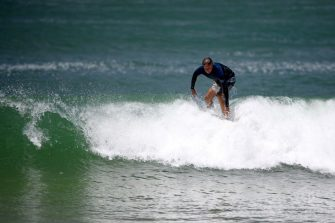 This picture taken on January 23, 2021 shows Bruce Lucas, an Australian shark attack survivor, surfing on Crowdy Bay National Park at Port Macquarie, some 127 kilometres (79 miles) northeast of Sydney. - Bruce Lucas was bitten while he fought off a bull shark at Saltwater beach on the mid north coast of New South Wales in 2015. (Photo by Wendell Teodoro / AFP) / TO GO WITH Australia-animal-shark,FOCUS (Photo by WENDELL TEODORO/AFP via Getty Images)