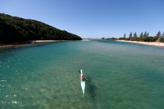 GOLD COAST, AUSTRALIA - APRIL 16: A kayaker enjoys Tallebudgera creek on April 16, 2020 in Gold Coast, Australia. The Federal Government has closed all non-essential business and implemented strict social distancing rules, while public gatherings are now limited to two people. New South Wales and Victoria have enacted additional lockdown measures to allow police the power to fine people who breach the two-person outdoor gathering limit or leave their homes without a reasonable excuse. Queensland, Western Australia, South Australia, Tasmania and the Northern Territory have all closed their borders to non-essential travellers and international arrivals into Australia are being sent to mandatory quarantine in hotels for 14 days. (Photo by Chris Hyde/Getty Images)