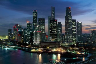 UNSPECIFIED - JULY 24:  Skyscrapers lit up at night in a city, Singapore City, Singapore  (Photo by DEA / M. BORCHI/De Agostini via Getty Images)