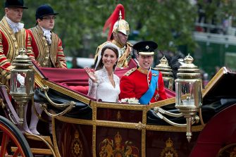 Catherine, Duchess of Cambridge and Prince William, Duke of Cambridge make the journey by carriage in procession to Buckingham Palace past crowds of spectators following their marriage at Westminster Abbey, London, 29th April 2011. The marriage of the second in line to the British throne was led by the Archbishop of Canterbury and was attended by 1900 guests, including foreign Royal family members and heads of state. Thousands of well-wishers from around the world have also flocked to London to witness the spectacle and pageantry of the Royal Wedding. (Photo by Tom Stoddart/Getty Images)