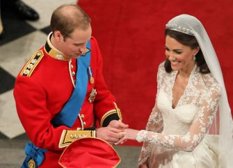 LONDON, ENGLAND - APRIL 29:  Prince William exchanges rings with his bride Catherine Middleton in front of the Archbishop of Canterbury, Rowan Williams inside Westminster Abbey on April 29, 2011 in London, England.  The marriage of Prince William, the second in line to the British throne, to Catherine Middleton is being held in London today. The marriage of the second in line to the British throne is to be led by the Archbishop of Canterbury and will be attended by 1900 guests, including foreign Royal family members and heads of state. Thousands of well-wishers from around the world have also flocked to London to witness the spectacle and pageantry of the Royal Wedding.  (Photo by Andrew Milligan - WPA Pool/Getty Images)