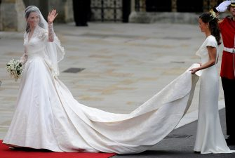 Kate Middleton waves as she arrives at the West Door of Westminster Abbey in London for her wedding to Britain's Prince William, on April 29, 2011.  AFP PHOTO / ODD ANDERSEN        (Photo credit should read ODD ANDERSEN/AFP via Getty Images)