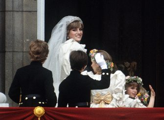 The Princess of Wales poses on the balcony of Buckingham Palace with a group of bridesmaids and pageboys, on the day of her wedding to the Prince of Wales, 29th July 1981. (Photo by Terry Fincher/Princess Diana Archive/Getty Images)