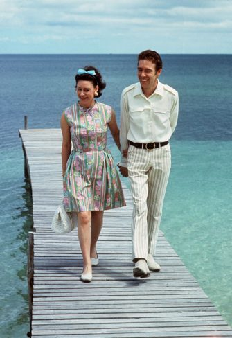 NASSAU, BAHAMAS - MARCH 14:  Princess Margaret, the younger sister of Britain's Queen Elizabeth II, walks 14 March 1967 with her husband Earl of Snowdon on a pontoon in the Bahamas. Princess Margaret and the Earl of Snowdon had two children, son Linley and daughter Sarah, but announced their separation in March 1976. When the marriage was officially ended two years later, Margaret became the first royal to divorce since Henry VIII in the 16th century.  (Photo credit should read DALMAS/AFP via Getty Images)