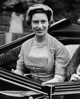 17th June 1952:  Princess Margaret (1930 - 2002) is driven to the opening meeting of the Royal Ascot horse-racing event near Windsor in Berkshire.  (Photo by Fox Photos/Getty Images)