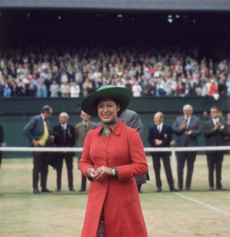 4th July 1970:  Princess Margaret (1930 - 2002) on centre court at Wimbledon to present John Newcombe with the Men's Singles Trophy.  (Photo by Mike Lawn/Fox Photos/Getty Images)