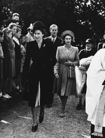 Princess Elizabeth, front, and Princess Margaret Rose, who follows, as they attend the christening of six-weeks-old Rosemary Elizabeth, daughter of Hon. Andrew Elphinstone and Mrs. Elphinstone, Sept. 30, 1947, Maryland, Worplesdon, Surrey, England. Princess Elizabeth acted as godmother at the ceremony. Lt. Philip Mountbatten, Princess Elizabeths fiancà , follows the princesses as the group arrives at Parish Church. (AP Photo)