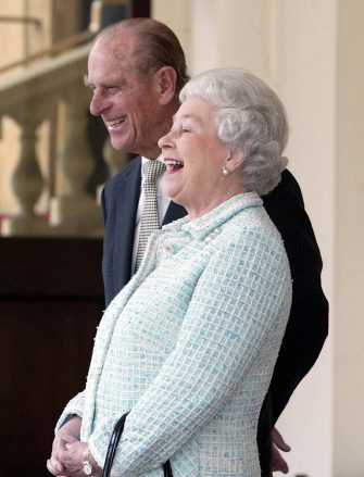 Britain's Queen Elizabeth II and Prince Phillip laugh, as President Alexandre Kwasniewski of Poland and his wife Jolanta Kwasniewska left Buckingham Palace in London, Friday May 7, 2004, after an official  two day State Visit to the United Kingdom(AP Photo/Dave Caulkin, pool)