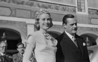 American actress Grace Kelly (1929  1982) on the day of her civil wedding to Rainier III, Prince of Monaco, at the Prince's Palace of Monaco, 18th April 1956. The man on the right is Count Fernand-Léopold-Marie-Joseph Caillard D'Aillieres, Prince Rainier's chamberlain. Original publication: Picture Post - 8336 - The Hour Of Marriage - pub. 28th April 1956 (Photo by Haywood Magee/Picture Post/Hulton Archive/Getty Images)