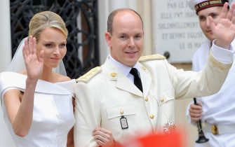 MONACO - JULY 02:  Princess Charlene of Monaco and Prince Albert II of Monaco wave to the crowd as they leave Sainte Devote church after their religious wedding ceremony at the Prince's Palace of Monaco on July 2, 2011 in Monaco. The Roman-Catholic ceremony followed the civil wedding which was held in the Throne Room of the Prince's Palace of Monaco on July 1. With her marriage to the head of state of the Principality of Monaco, Charlene Wittstock has become Princess consort of Monaco and gains the title, Princess Charlene of Monaco. Celebrations including concerts and firework displays are being held across several days, attended by a guest list of global celebrities and heads of state.  (Photo by Gareth Cattermole/Getty Images)
