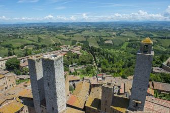 ITALY - 2013/06/04: View from a tower of the medieval walled hill town of San Gimignano in Tuscany, Italy and the surrounding landscape. (Photo by Wolfgang Kaehler/LightRocket via Getty Images)