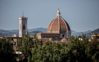 The Santa Maria del Fiore Cathedral (Cattedrale di Santa Maria del Fiore), also known as the Duomo, and Giottoâ  s Campanile, left, are seen from the Giardino di Boboli garden on June 25, 2016 in Florence, Italy. Florence is among Italy's most popular tourist destinations.