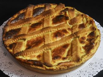 NAPLES, CAMPANIA, ITALY - 2017/12/23: Typical dessert neapolitan Pastiera, with ricotta and cheese. (Photo by Salvatore Laporta/KONTROLAB /LightRocket via Getty Images)