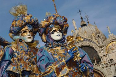 VENICE, ITALY - FEBRUARY 23: Traditionaly masked Venetians pose on San Marco square during the Carnival February 23, 2006 in Venice, Italy. The Carnival traditionally celebrates the passing of winter with parties, balls and costumes in the run-up to the Christian observation of Lent. (Photo by Franco Origlia/Getty Images)
