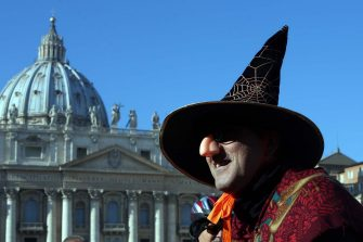 VATICAN CITY, VATICAN - JANUARY 06:  A person dressed as Befana waits in St Peter's Square during the Feast of the Epiphany for Pope Francis' Angelus blessing on January 6, 2015 in Vatican City, Vatican. In Italian folk law, an old woman called Befena delivers presents to children in Italy on the eve of the Epiphany. During his homily at the Epiphany mass today, the Pope Francis focused on the journey taken by the three wise men, which is celebrated today, and encouraged Catholics to keep a strong faith. (Photo by Franco Origlia/Getty Images)
