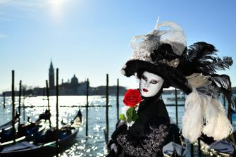 TOPSHOT - A reveller wearing a mask and a period costume takes part in the Venice Carnival on February 15, 2020. (Photo by Alberto PIZZOLI / AFP) (Photo by ALBERTO PIZZOLI/AFP via Getty Images)