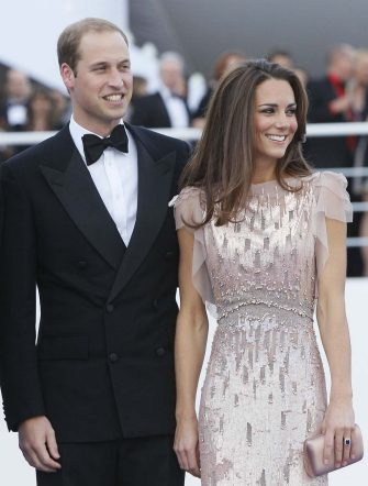 FILE-   Britain's Prince William, the Duke of Cambridge, and his wife Kate, Duchess of Cambridge arrive at a charity event for Absolute Return for Kids, ARK, in  London, in this Thursday, June, 9, 2011 file photo. The Duchess of Cambridge is on the latest Vanity Fair International Best Dressed List.  She had appeared once before, in 2008.   (AP Photo/Alastair Grant, file)