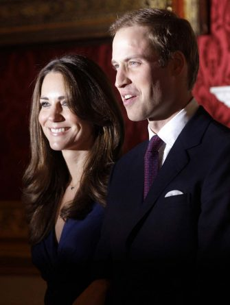 Britain's Prince William and his fiance Kate Middleton pose for the media at St. James's Palace in London after announcing their engagement,  Tuesday, Nov. 16, 2010. (AP Photo/Sang Tan)