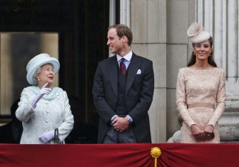 Britain's Queen Elizabeth II, left, looks on as Prince William, and Kate, Duchess of Cambridge appear on the balcony of Buckingham Palace in central London, Tuesday, June 5, 2012, to conclude the four-day Diamond Jubilee celebrations to mark the 60th anniversary of the Queen's accession to the throne. (AP Photo/Lefteris Pitarakis)