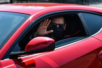 Juventus' Italian defender Leonardo Bonucci, wearing a face mask, gestures as he arrives in his car at the Juventus' Continassa training ground in Turin on May 5, 2020, during the country's lockdown aimed at curbing the spread of the COVID-19 infection, caused by the novel coronavirus. - Juventus has recalled its 10 overseas players as Serie A clubs were given the green light to return to individual training on May 4, 2020. Players returning from abroad are to follow a health protocol and then begin training at Continassa. (Photo by Marco BERTORELLO / AFP) (Photo by MARCO BERTORELLO/AFP via Getty Images)