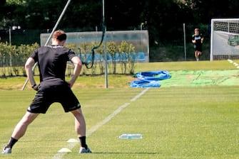 Due giocatori del Sassuolo in allenamento a distanza  su uno dei campi del Mapei Football Center per l allenamento individuale.Sassuolo, Modena, 04 Maggio 2020.  ANSA /ELISABETTA BARACCHI
