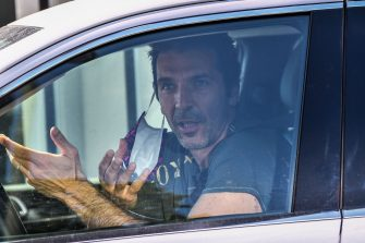TOPSHOT - Juventus' Italian goalkeeper Gianluigi Buffon gestures as he arrives in his car to attend a training session on May 18, 2020 at the Continassa training ground in Turin during the country's lockdown aimed at curbing the spread of the COVID-19 infection, caused by the novel coronavirus. (Photo by Marco Bertorello / AFP) (Photo by MARCO BERTORELLO/AFP via Getty Images)