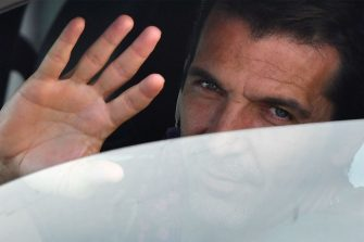 Juventus' Italian goalkeeper Gianluigi Buffon waves as he arrives in his car to attend a training session on May 18, 2020 at the Continassa training ground in Turin during the country's lockdown aimed at curbing the spread of the COVID-19 infection, caused by the novel coronavirus. (Photo by Marco Bertorello / AFP) (Photo by MARCO BERTORELLO/AFP via Getty Images)