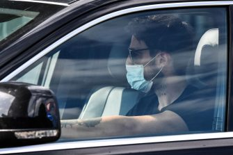 Juventus' Uruguayan midfielder Rodrigo Bentancur, wearing a face mask, arrives in his car to attend a training session on May 18, 2020 at the Continassa training ground in Turin during the country's lockdown aimed at curbing the spread of the COVID-19 infection, caused by the novel coronavirus. (Photo by Marco Bertorello / AFP) (Photo by MARCO BERTORELLO/AFP via Getty Images)