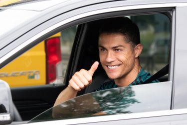 TURIN, ITALY - MAY 19: Juventus' Portuguese forward Cristiano Ronaldo exit in his car to resume training after a quarantine on May 19, 2020 at the club's Continassa training ground in Turin, as the country's lockdown is easing after over two months, aimed at curbing the spread of the COVID-19 infection, caused by the novel coronavirus. during the   Cristiano Ronaldo arrival at the Turin on May 19, 2020 in Turin Italy (Photo by Mattia Ozbot/Soccrates/Getty Images)