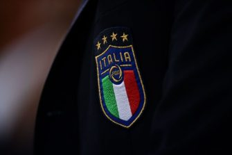The Italian Football Federation (FIGC) four-star logo, representing the countrys World Cup triumphs, is pictured on the jacket of Italy's head coach Roberto Mancini prior to the friendly football match Italy vs Ukraine on October 10, 2018 at the Luigi-Ferraris stadium in Genoa. (Photo by Marco BERTORELLO / AFP) (Photo by MARCO BERTORELLO/AFP via Getty Images)