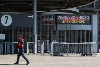 MILAN, ITALY - MARCH 08:  A man walks past a notice indicating the closure of the stadium is displayed before the Serie A match between AC Milan and Genoa CFC at Stadio Giuseppe Meazza, (also known as the San Siro stadium) on March 8, 2020 in Milan, Italy.  (Photo by Marco Luzzani/Getty Images)