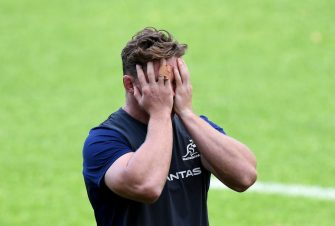 BRISBANE, AUSTRALIA - JULY 25: Michael Hooper puts his hands in his face as he applies sunblock to his face during a Wallabies training session at Ballymore Stadium on July 25, 2019 in Brisbane, Australia. (Photo by Bradley Kanaris/Getty Images)
