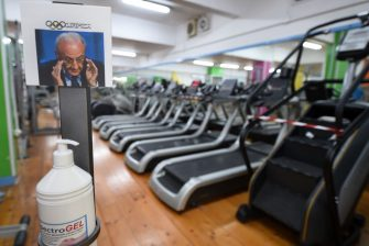 SALERNO, ITALY - MAY 23: Hand sanitizer gel is displayed near a Vincenzo De Luca picture at the Olimpica Gym entrance on May 23, 2020 in Salerno, Italy. Restaurants, bars, cafes, hairdressers and other shops have reopened, subject to social distancing measures, after more than two months of a nationwide lockdown meant to curb the spread of Covid-19. (Photo by Francesco Pecoraro/Getty Images)