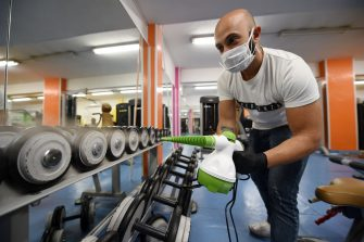SALERNO, ITALY - MAY 23: Marco Rarità, Olimpica Gym Personal Trainer, disinfects gym equipment on May 23, 2020 in Salerno, Italy. Restaurants, bars, cafes, hairdressers and other shops have reopened, subject to social distancing measures, after more than two months of a nationwide lockdown meant to curb the spread of Covid-19. (Photo by Francesco Pecoraro/Getty Images)