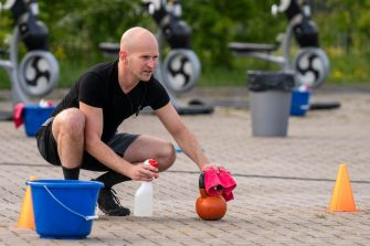 JOURE, NETHERLANDS - MAY 18: A man cleans gym equipment at an open air gym during the COVID-19 pandemic on May 18, 2020 in Joure, Netherlands. (Photo by Douwe Bijlsma/BSR Agency/Getty Images)