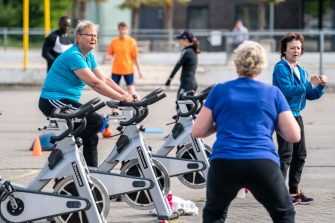 JOURE, NETHERLANDS - MAY 18: A woman exercises on a stationary bike outside after gyms remain closed during the COVID-19 pandemic on May 18, 2020 in Joure, Netherlands. (Photo by Douwe Bijlsma/BSR Agency/Getty Images)