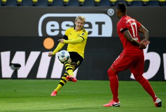 epa08445332 Jerome Boateng (R) and Dortmund's Julian Brandt in action during the German Bundesliga soccer match between Borussia Dortmund and FC Bayern Munich at Signal Iduna Park in Dortmund, Germany, 26 May 2020.  EPA/Federico Gambarini / POOL DFL regulations prohibit any use of photographs as image sequences and/or quasi-video.