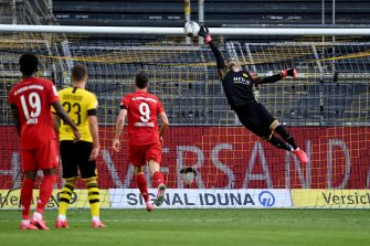 epa08445438 Dortmund's goalkeeper Roman Buerki (R) concedes the 0-1 goal scored by Bayern Munich's Joshua Kimmich (not pictured) during the German Bundesliga soccer match between Borussia Dortmund and FC Bayern Munich at Signal Iduna Park in Dortmund, Germany, 26 May 2020.  EPA/Federico Gambarini / POOL DFL regulations prohibit any use of photographs as image sequences and/or quasi-video.