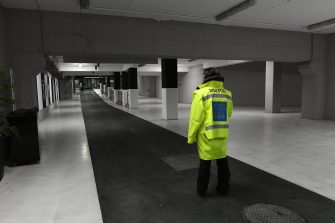 A stadium steward stands in an empty corridor of the Juventus stadium before the Italian Serie A football match Juventus vs Inter Milan which will be played behind closed doors, in Turin on March 8, 2020. - Italy on March 8, 2020, had the second-highest coronavirus toll in the world, after reporting a sharp jump in both deaths and number of infected people, according to an AFP count. The number of fatalities shot up by 133 to 366 on March 8, while the number of infections rose by a single-day record of 1,492 to hit 7,375, its civil protection agency said. (Photo by Vincenzo PINTO / AFP) (Photo by VINCENZO PINTO/AFP via Getty Images)