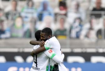 epa08456367 Moenchengladbach players Mamadou Doucoure (L) and Marcus Thuram (R) celebrate after winning the German Bundesliga soccer match between Borussia Moenchengladbach and Union Berlin in Moenchengladbach, Germany, 31 May 2020.  EPA/MARTIN MEISSNER / POOL CONDITIONS - ATTENTION: The DFL regulations prohibit any use of photographs as image sequences and/or quasi-video.
