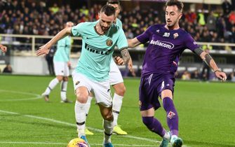 Inter's midfielder Marcelo Brozovic (L) against Fiorentina's midfielder Gaetano Castrovilli (R) during the Italian Serie A soccer match between ACF Fiorentina and Inter FC at the Artemio Franchi stadium in Florence, Italy, 15 December 2019 ANSA/CLAUDIO GIOVANNINI