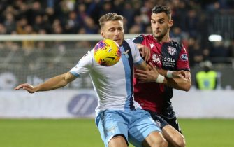 Cagliari's Charalampos Lykogiannis (R) and Lazio's Ciro Immobile in action during the Italian Serie A soccer match Cagliari Calcio vs SS Lazio at Sardegna Arena stadium in Cagliari, Sardinia island, Italy,16 December 2019. ANSA/FABIO MURRU
