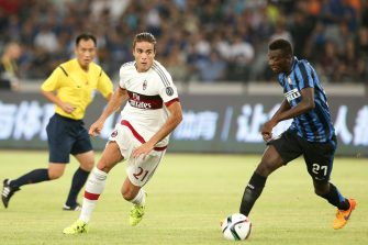 SHENZHEN, CHINA - JULY 25: (CHINA OUT) Alessandro Matri #21 of AC Milan and Assane Demoya Gnoukouri #27 of Inter Milan compete for the ball during the International Champions Cup match between AC Milan and Inter Milan at Longgang Sports Center on July 25, 2015 in Shenzhen, China. (Photo by Wu Zhizhao/ChinaFotoPress)***_***