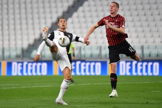 TURIN, ITALY - JUNE 12:  Cristiano Ronaldo (L) of Juventus competes for the ball with Andrea Conti of AC Milan during the Coppa Italia Semi-Final Second Leg match between Juventus and AC Milan at Allianz Stadium on June 12, 2020 in Turin, Italy.  (Photo by Valerio Pennicino/Getty Images)
