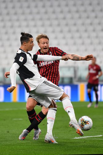 TURIN, ITALY - JUNE 12:  Cristiano Ronaldo (L) of Juventus kicks the ball against Simon Kjaer of AC Milan during the Coppa Italia Semi-Final Second Leg match between Juventus and AC Milan at Allianz Stadium on June 12, 2020 in Turin, Italy.  (Photo by Valerio Pennicino/Getty Images)
