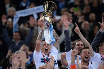 Napoli's Slovakian midfielder Marek Hamsik (L) holds the trophy after winning the Italian Tim Cup football final (1-3) between Fiorentina and Napoli on May 3, 2014 at the Olimpico stadium in Rome. Ten-man Napoli overcame dramatic scenes prior to kick-off at the Olympic Stadium to claim their second Italian Cup trophy in three years with a 3-1 win over Fiorentina on Saturday. Lorenzo Insigne scored a first-half brace for Napoli inside 16 minutes and although Juan Vargas reduced the arrears on 28 minutes, Dries Mertens scored a third in injury time. AFP PHOTO / FILIPPO MONTEFORTE        (Photo credit should read FILIPPO MONTEFORTE/AFP via Getty Images)