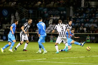 DOHA, QATAR - DECEMBER 22:Gonzalo Higuain of Napoli scores their second goal  during the 2014 Italian Super Cup match between Juventus FC v SSC Napoli at the Jassim Bin Hamad Stadium on December 22, 2014 in Doha, Qatar.  (Photo by Francois Nel/Getty Images)