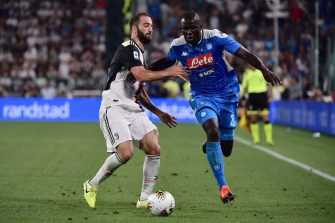 Juventus' Argentinian forward Gonzalo Higuain (L) vies with Napoli's Senegalese defender Kalidou Koulibaly during the Italian Serie A football match Juventus vs Napoli on August 31, 2019 at the Juventus stadium in Turin. (Photo by Marco Bertorello / AFP)        (Photo credit should read MARCO BERTORELLO/AFP via Getty Images)